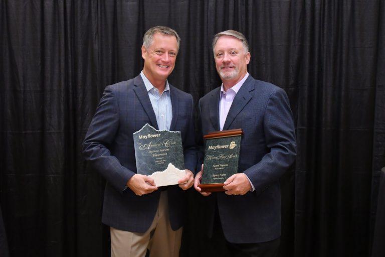 Rick and Chip Dircks posing with awards.