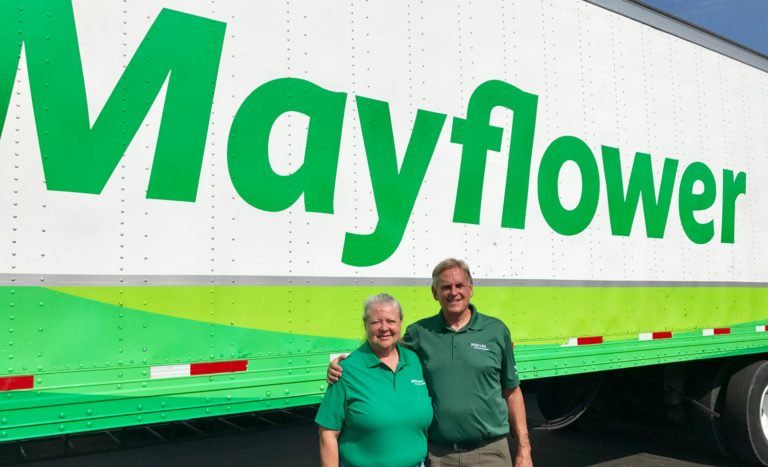 Gary and Donna Eaves in front of Mayflower truck.