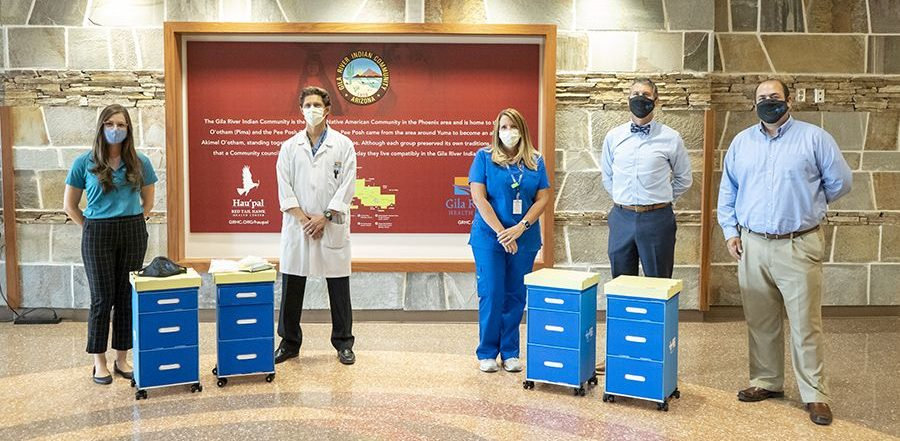 Medical staff and team posing with bedside carts